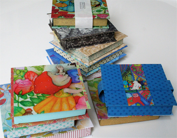 All the objects are made from a plastic compound, and are all inspired by my books. I enjoy making individual boxes for each item.