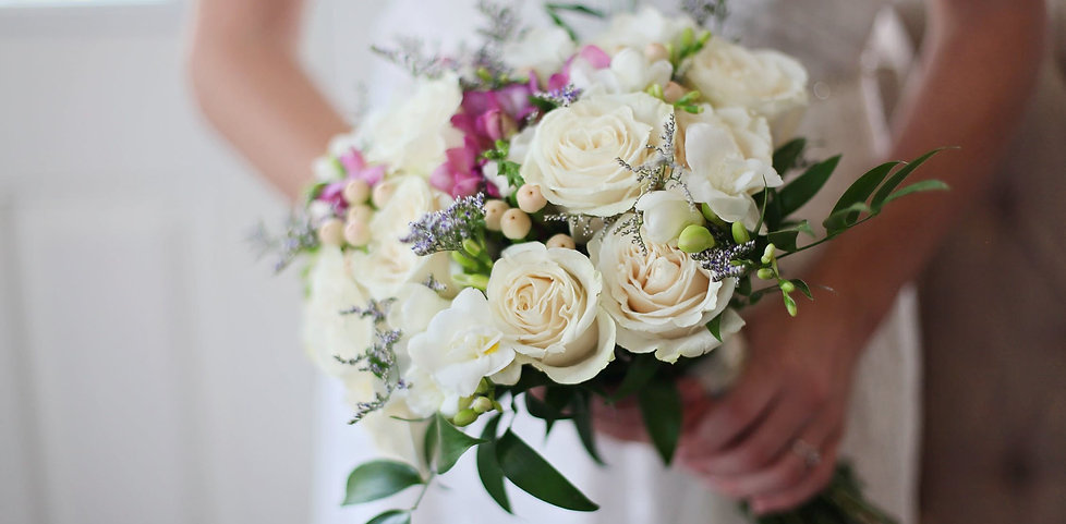 A bride with a bouquet of roses