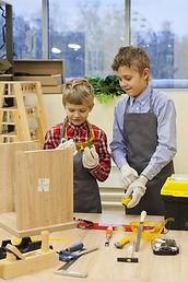 children in the workshop construct woode