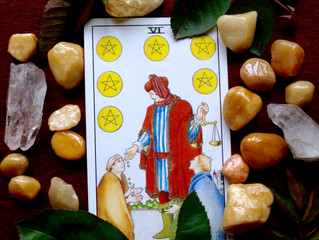 The Season of Giving and the Six of Pentacles
