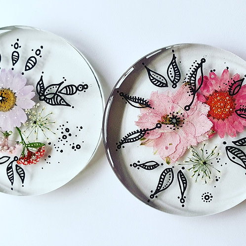 Clear, floral coaster with design.