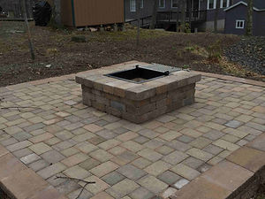 Hardsape with central fire pit