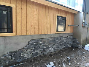 Siding with Partially complete Stone Work