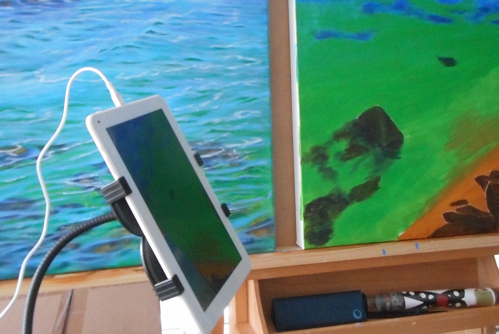 Tablet being used with a tablet holder