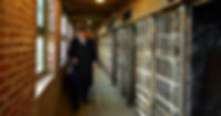 Walking down a cell block corridor which