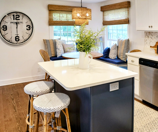 Full Kitchen View - Banquette Seating, Island with Stools, and Statement Clock