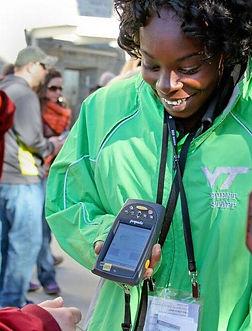 A ticket scanner employee working at Virginia Tech