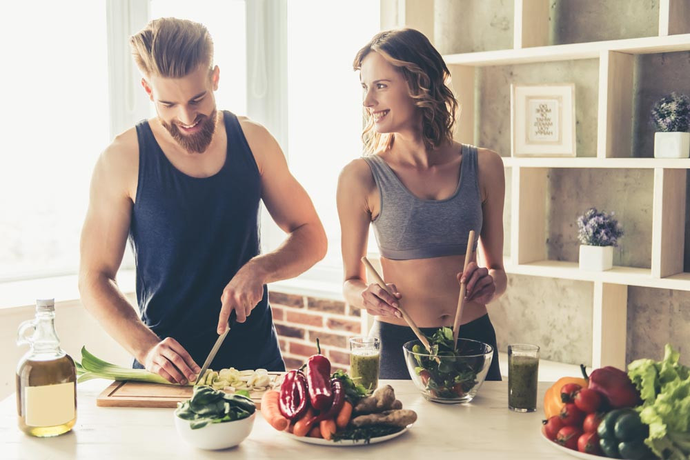 12southrecovery-7-Simple-Ways-to-Manage-Depression-in-Recovery-photo-of-beautiful-young-sports-people-preparing-healthy-meal