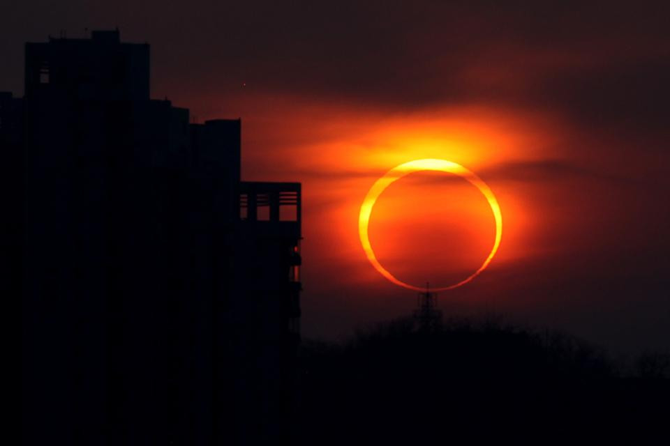 an image of full annular eclipse forming a ring of Sunlight around moon shadow called ring of fire.