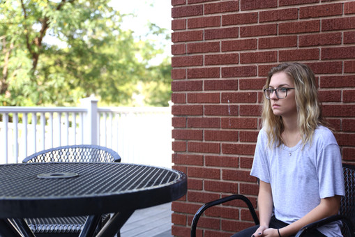 Asbury student Madeline Mullenbach looks around the empty Stuce porch