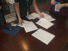 Laura Oswald, marketing director of the Paducah Visitors Bureau, prepares the UNSECO declaration for delegates to sign
