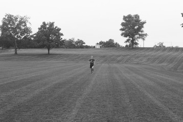 Cross-country runner Hayden Dwyer races across the field at Asbury