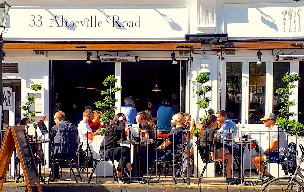 Outdoor dining alfresco in Abbeville Road, Clapham, London, UK