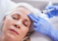 beautician-giving-mature-female-patient-