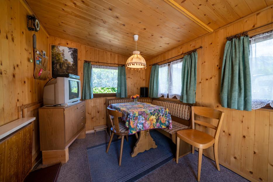Bellerive Camping Wohnwagen Ansicht drinnen Sitzgelegenheit