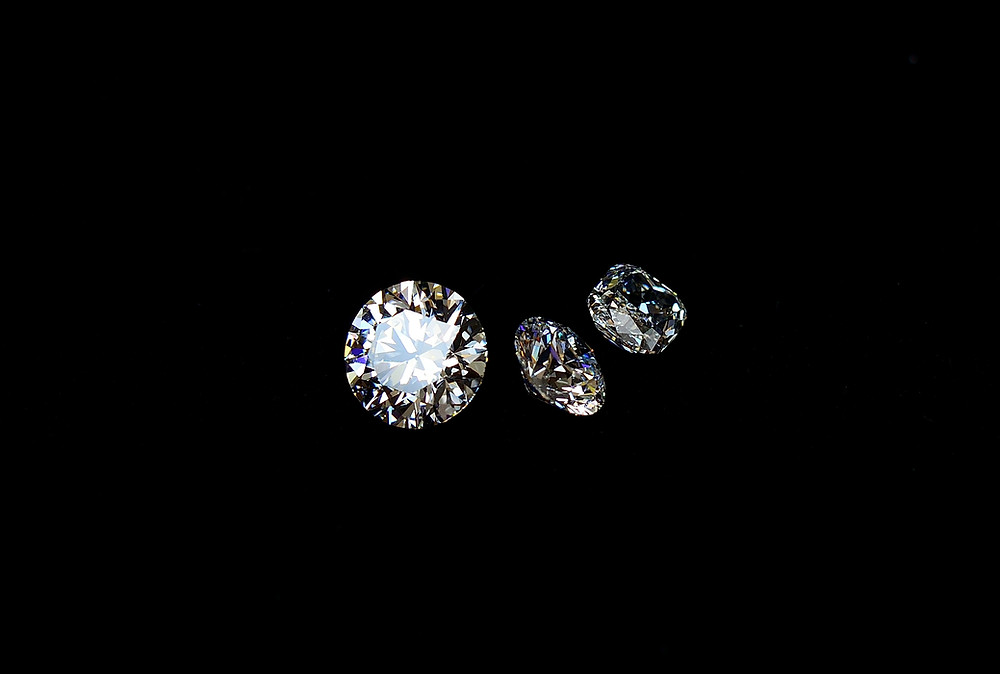 Three diamonds sitting against black background