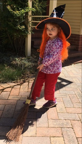 Halloween Witch wearing Lilac Breezy top and rainbow red Possum Pants