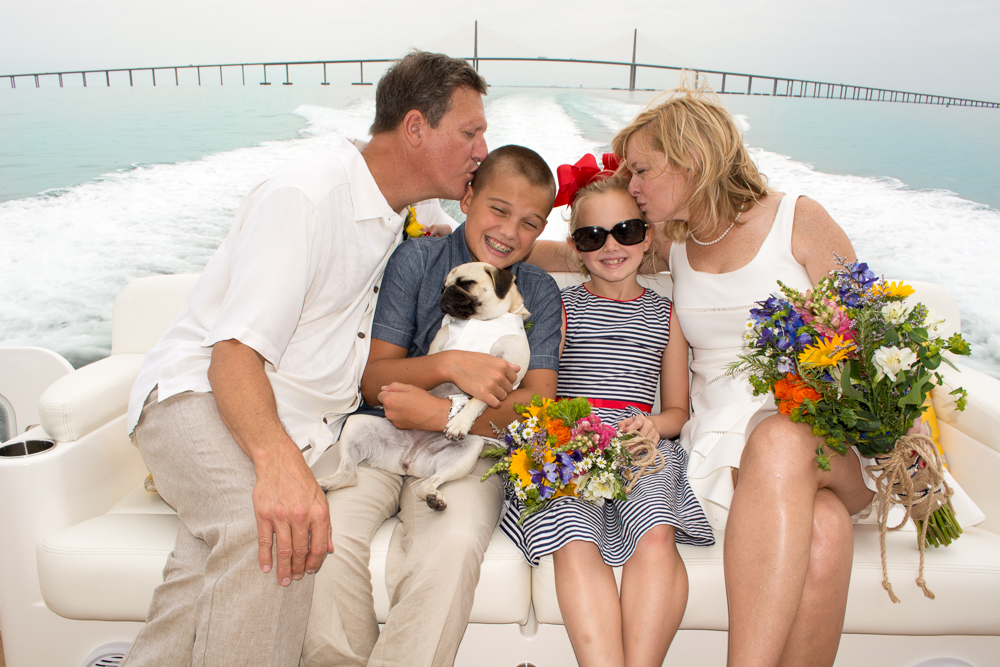 Family on Yacht with Dog.