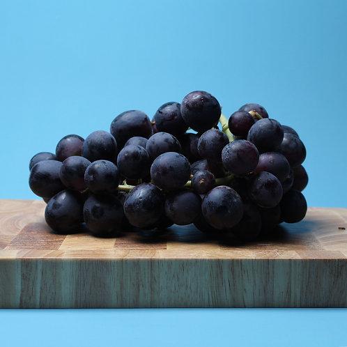 Punnet of black grapes