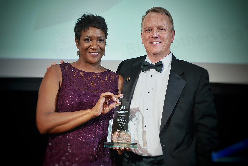 CEO & President of Big Brothers Big Sisters of Metropolitan Detroit- Jeannine Gant presented the Clifford P. Normand Award to Richard Hampson, President of Citizens Bank, Michigan for his outstanding service as BBBSMD Board Secretary