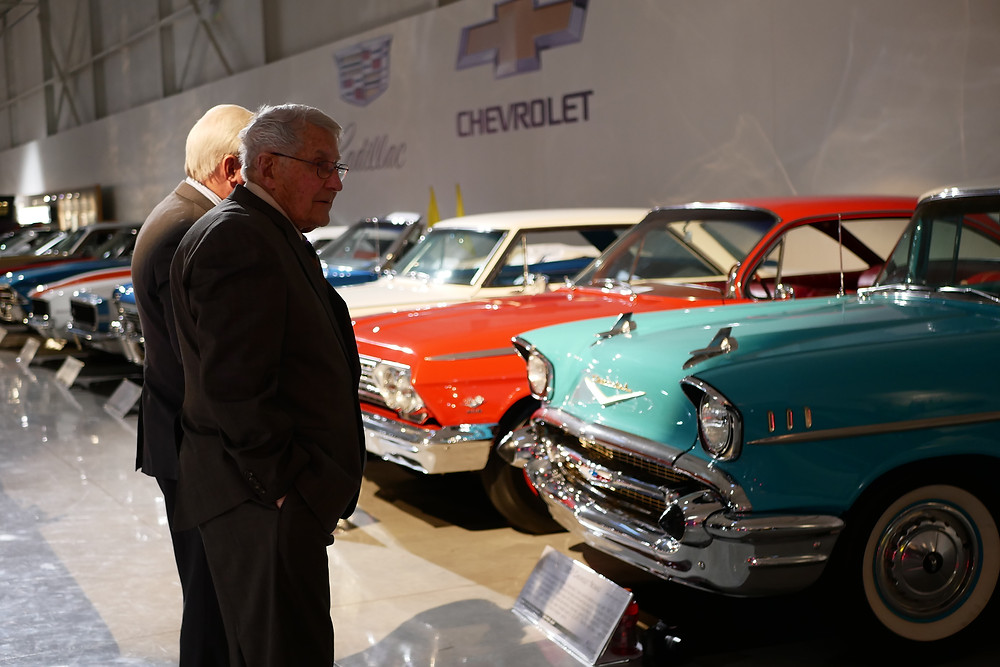 Guest admire the many GM vehicles on display Friday night.