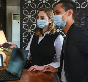 Reception and check in with masks.JPG
