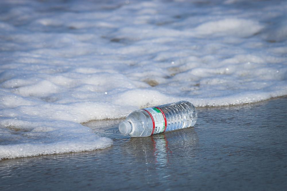 Single-Use Plastic Water Bottle on a Beach