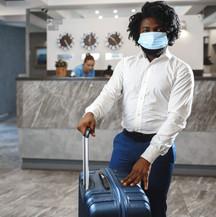 Man in hotel lobby in mask.jpg