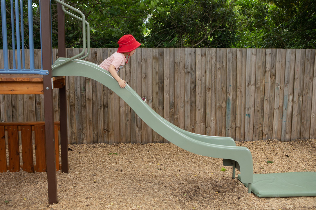 Outdoor play equipment slide at Doncaster East Daycare servicing the areas of Blackburn, Mitcham and Templestowe.
