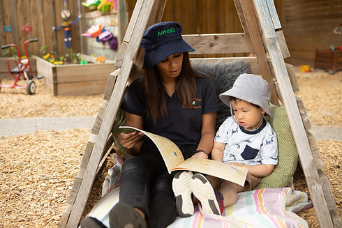 Educator at Doncaster East Daycare and Kindergarten in Doncaster East reading to child.
