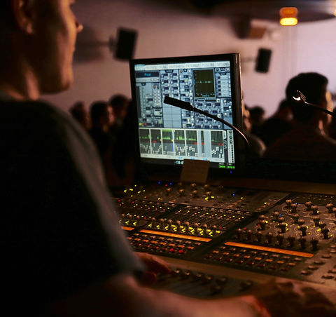 man in front of mixing console_edited_edited.jpg