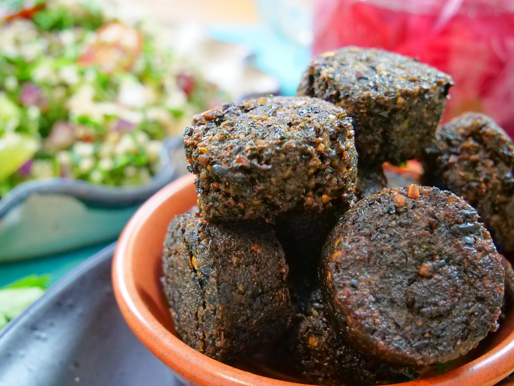 Falafels are deep-fried ball or patty and is a traditional Middle Eastern food. those black turtle beans make an amazing alternative from chickpeas as they are crunchier and look like black pudding, even delicious with some black garlic.