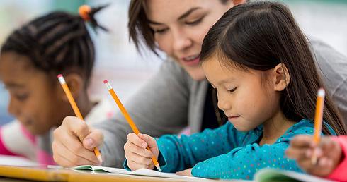 Teacher helping child with homework