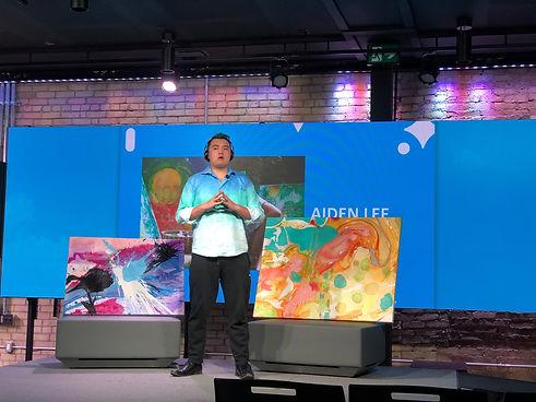 Artist Aiden Lee on a studio stage