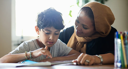 Mother helping child with homework.
