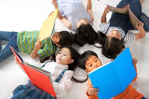Children reading colourful books