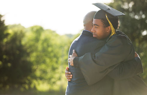 Father and son hugging at graduation.