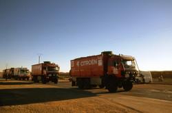 Big Camions drive through the desert