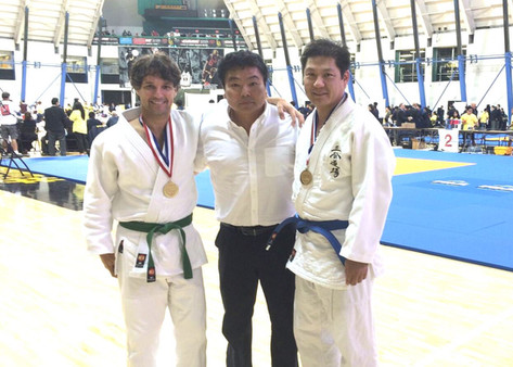 Proud coach, Chen and Frio take Gold