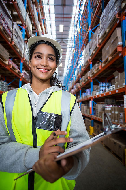 female-warehouse-worker-holding-on-clipb