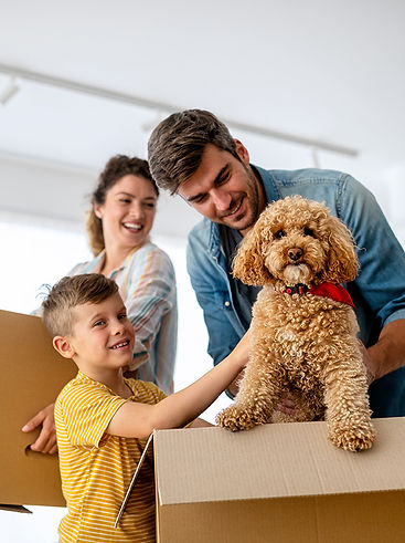 happy-family-with-children-moving-with-b