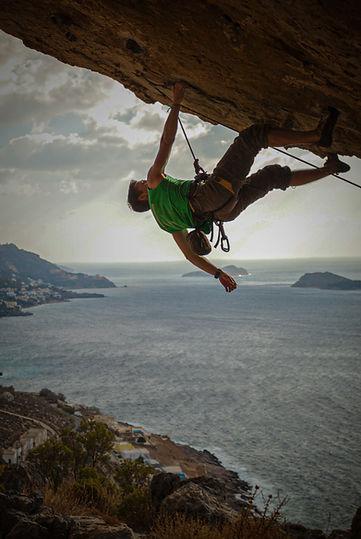 male-climber-climbing-overhanging-rock-a