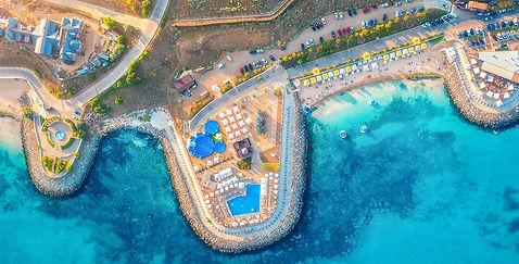 aerial-view-of-sandy-beach-blue-sea-rest