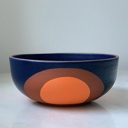 Phases largenserving bowl midnight blue & orange on dark, rich red clay