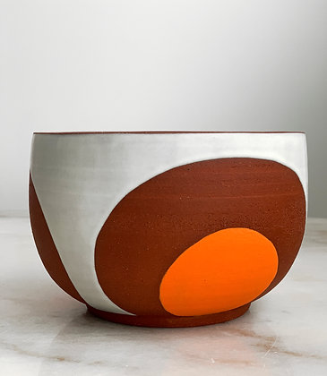 Phases serving bowl red, orange, and white