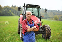 organic-farmer-standing-front-his-red-tr