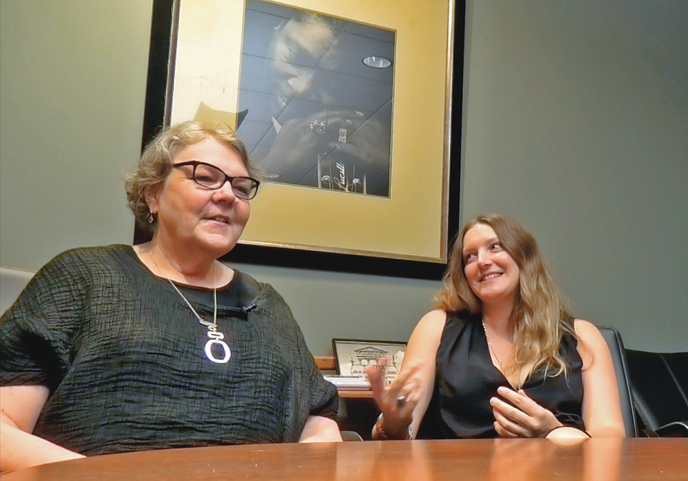 Seated beneath a portrait of BB King at the BB King Museum in Indianola, Mississippi, Vickie Benson (left) and Savannah Barrett (right) talk about the issues impacting rural creative placemaking.