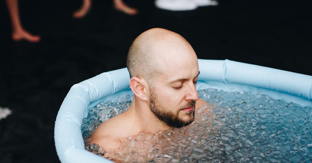 wim hof method man meditating in ice bath