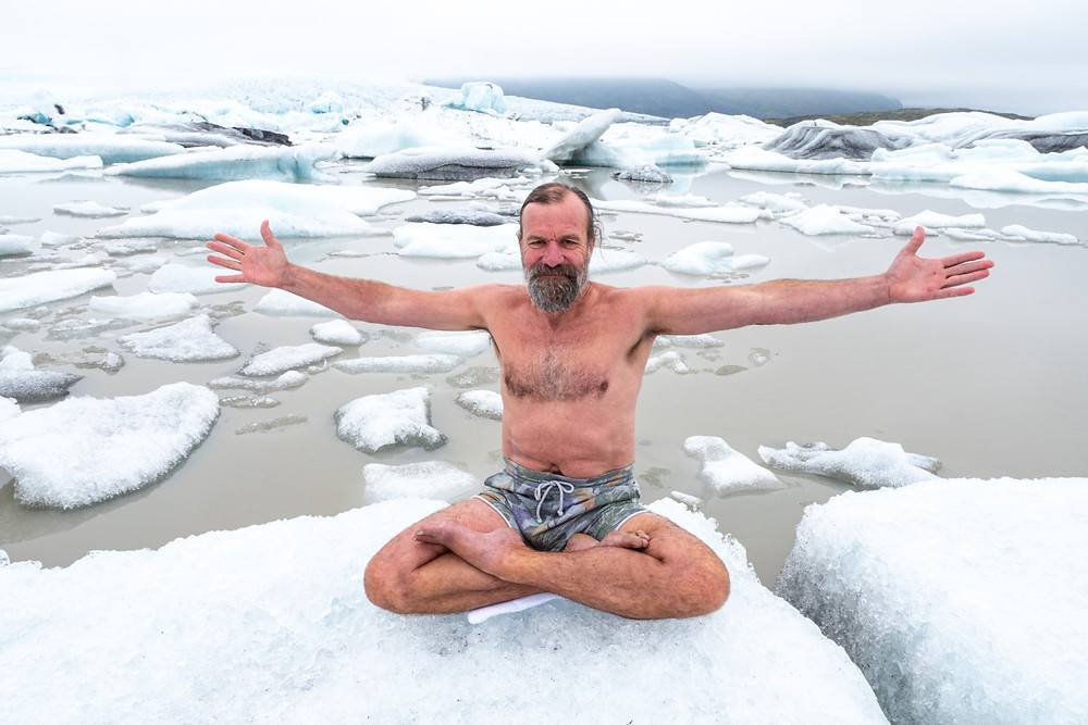 wim hof sitting on ice flow