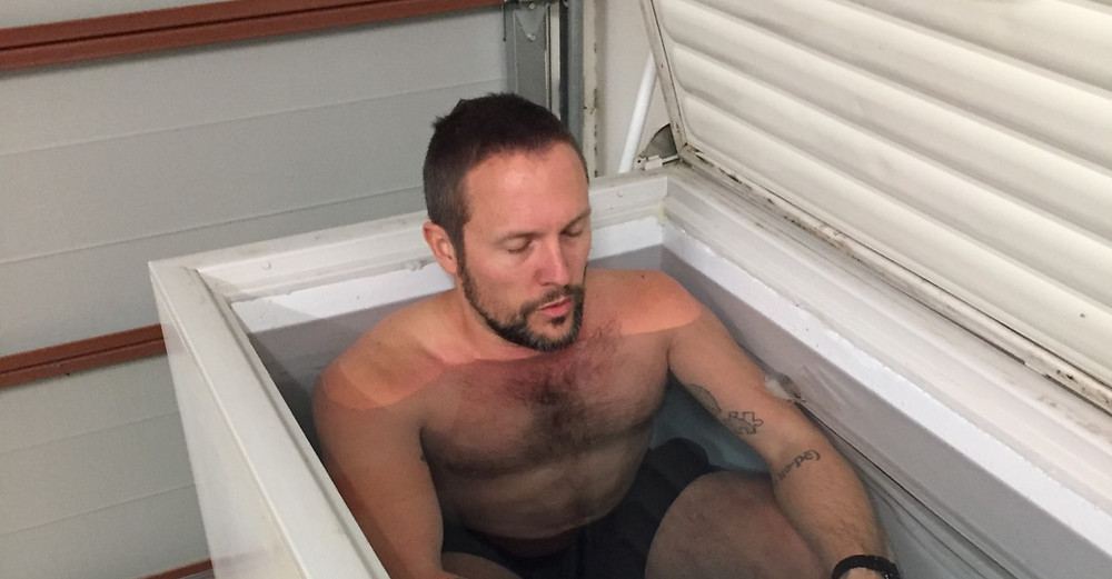 the author in a chest freezer cold plunge